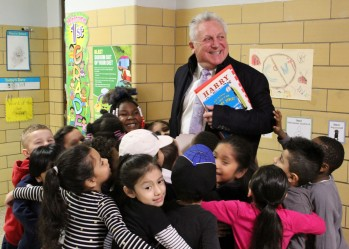 Tracey Elementary School students hug Norwalk Mayor Harry Rilling on Read Across America Day with guests from the community on Friday, March 2, 2018.