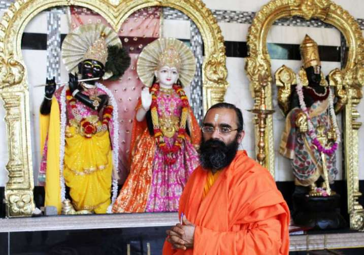 Swami Balgopal stands in front of the sacred stage in the Wilton Hindu Temple at 68 Westport Road on Tuesday, July 12, 2016.