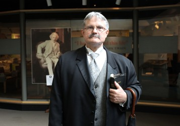 Living history tour guide Craig Hotchkiss, who plays Mark Twain's closest friend Joseph Hopkins Twichell, leads a group through the Mark Twain House and Museum in Hartford on June 4, 2018.