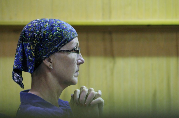 A woman, who didn't want to be identified, praying for healing after being diagnosed with cancer.