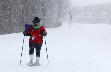 Virginia Hyde snowshoes down Old Ridgefield Road in Wilton on Thursday, Jan. 4, 2017.
