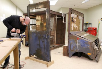 Greenwich art teacher Ben Quesnel is turning an abandoned mail truck into an interdisciplinary art installation at his studio in Wilton.
