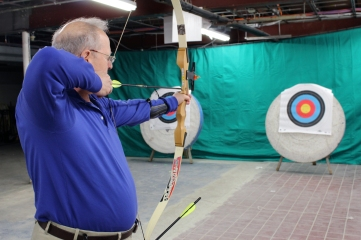 Sandy Block, of Weston, prepares to release his second arrow after hitting the bull's-eye during Wilton Archery Club's grand opening on Thursday, April 13, at Way of the Sword, 21 Governor Street, in Ridgefield.