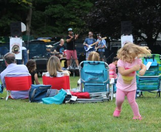 Lexi dances to One Bad Oyster during the final night of Wilton's summer concert series on Sunday, Aug. 6, 2017, at Merwin Meadows.