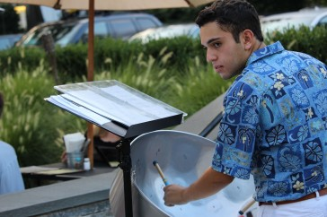 Stephen Blinder, 16, playing the steel drums at the Wilton Steel Community Band's performance on Tuesday, Aug. 16, at Wilton Pizza, 202 Town Green.
