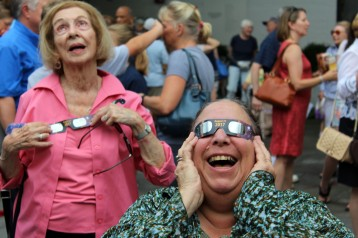 Viewers look at the solar eclipse from Wilton Library on Monday, Aug. 21, 2017.
