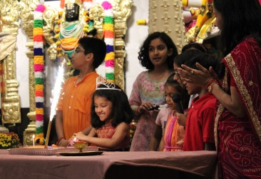More than 100 from the community joined the worship service at Hindu Wilton Temple on Tuesday, Sept. 26, 2017, after word spread about a vandalism incident the night before. They also celebrated one of the children's birthday.