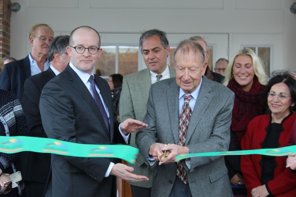 George Ciaccio, chairman emeritus of Wilton Commons, cuts the ribbon at the ceremony for Wilton Commons Congregate.